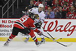 Mar 27; Newark, NJ, USA; Chicago Blackhawks defenseman Niklas Hjalmarsson (4) makes a pass while being defended by New Jersey Devils center Travis Zajac (19) during the second period at the Prudential Center.