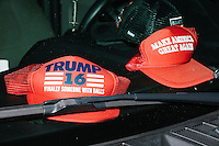 Hats in support of Republican presidential candidate Donald Trump lay on a pickup truck dashboard in Coconut Grove, Miami, Florida.