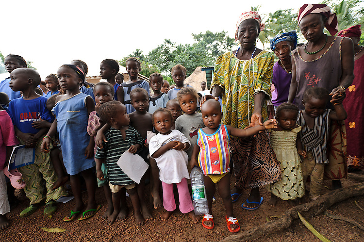 Children of Maboraba Village, nr Makeni, Sierra Leone.  Planting Promise sponsor a school at the village. Planting Promise is an organization dedicated to the development of education in Sierra Leone. Its aim is to bring opportunities to initiate self-run, self-supporting projects that offer real solutions to the difficulties facing the world's poorest country. They believe real and lasting development comes from below, from local projects that address specific needs, rather than large international models. To this end, they currently run five projects that aim to bring wealth into the country through business. The profits from these businesses are then used to support free education for children and adults...Through the combination of business with social progress, the charity hopes that they are providing real, lasting and profound changes for the better, by promoting sustainable and beneficial industry in the country, and putting it to the service to the needs of the people. As well as providing the income to fund the school, the farms will also be an example of successful commercial enterprise to teach the children in the school the viability of profit-making schemes that go beyond subsistence models, the only things the children of these desperately poor areas are accustomed to. By learning particular details of the challenges that they will face, the children will emerge from this school equipped to contribute in a real way to their society.