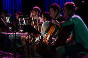 A small string orchestra watches during the rehearsal for Matthew E. White's One Incantation Under God at Fletcher Opera Theater during Hopscotch, Raleigh, NC, September 6, 2012.