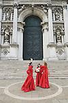 Venice Italy 2009. Three actors outside the church of Santa Maria della Salute.