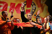 """Kiev, Ukraine.December 26, 2004..Opposition candidate Viktor Yushchenko takes center stage on Maidan Independence Square as thousands of Orange flag waving supporters rally to his side. Election polls show him in a strong lead just hours after the polling stations close. ..He is joined on stage by his wife Kathy, his son and his political partner Yulia Timoshenko. On the far right is Ruslana, the famous Ukrainian singer who won the 2004 Eurovision song contest...The first round of voting was considered fraudulent when the ruling president Viktor Yahukovich won and the opposition candidate Viktor Yushchenko lost. ..Several hundred thousand Ukrainians took to the streets of Kiev and held daily rallies on Maidan Independence Square. The protests lasted nearly a month before the first vote was declared invalid and a new round of elections held on December 26, 2004. ..The demonstrations would come to be known as the """"Orange Revolution"""" after the color of the opposition party."""