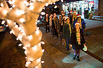 The Mountain View High School madrigals sing while they stroll down State Street.