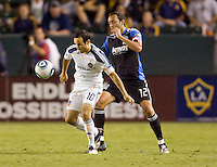San Jose Earthquake defender Ramiro Corrales (12) and LA Galaxy forward Landon Donovan (10) battle for a loose ball. The LA Galaxy and the San Jose Earthquakes played to a 2-2 draw at Home Depot Center stadium in Carson, California on Thursday July 22, 2010.