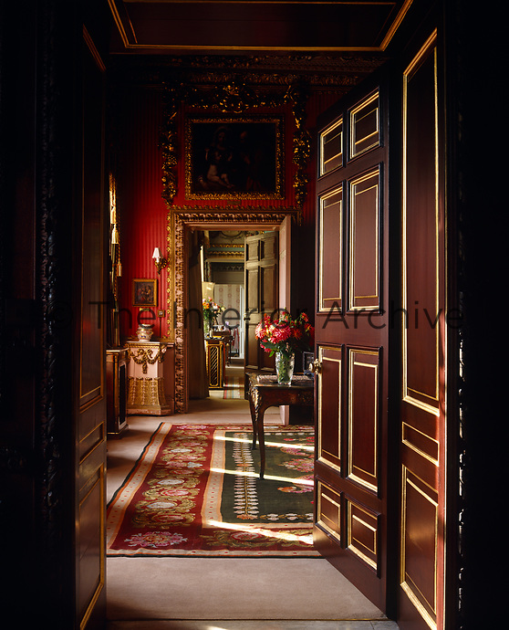 Grand doors open onto an enfilade of beautifully furnished rooms
