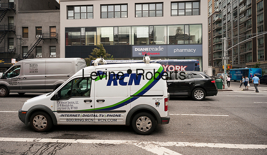 An RCN vehicle parked in New York on Thursday, August 18, 2016. The private-equity firm TPG will buy RCN Telecom Services for $1.6 billion and Grande Communications for $650 million. Both cable providers are being bought from Abry Partners LLC and Google Capital is buying a minority stake in both companies. (© Richard B. Levine)