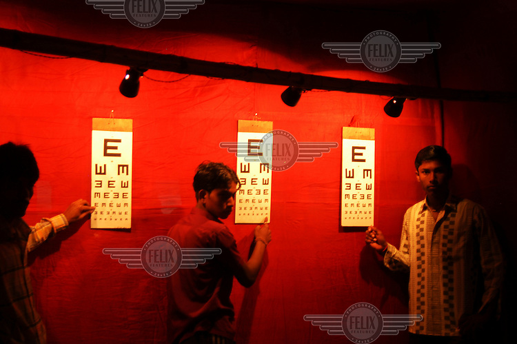 Children have their eyes tested in a slum area of Kolkta.
