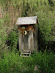 Wooden outhouse with crescent moon on the door, Colorado