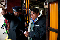 The train has a 320-passenger capacity. Inspector Juan Lazaro points a passenger in the direction of his car at Chilca Station in Huancayo.