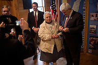 A woman poses for a picture with former Speaker of the House Newt Gingrich after Gingrich spoke at a town hall meeting in Lancaster, New Hampshire.  Gingrich is seeking the 2012 Republican nomination for president.