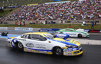 Jul. 20, 2014; Morrison, CO, USA; NHRA pro stock driver Allen Johnson (near) defeats Dave Connolly during the Mile High Nationals at Bandimere Speedway. Mandatory Credit: Mark J. Rebilas-