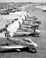 View of F-86 airplanes on the flight line getting ready for combat.  June 1951.  Air Force. (USIA)<br /> Exact Date Shot Unknown<br /> NARA FILE #:  306-PS-51-9760<br /> WAR &amp; CONFLICT BOOK #:  1413
