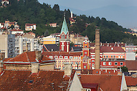 Chimney of the Sarajevo Brewery and the tower of the Catholic Church of St Anthony of Padua, Sarajevo, Bosnia and Herzegovina. Founded by the Ottomans in 1461, the city sits in the Sarajevo Valley surrounded by the Dinaric Alps. Picture by Manuel Cohen