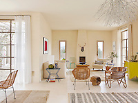 The open-plan living space is light, spacious, comfortable and furnished with a collection of contemporary pieces