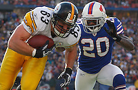 BUFFALO, NY - NOVEMBER 28:  Heath Miller #83 of the Pittsburgh Steelers runs out of bounds with the ball after completing a catch in front of Donte Whitner #20 of the the Buffalo Bills during the game on November 28, 2010 at Ralph Wilson Stadium in Buffalo, New York.  (Photo by Jared Wickerham/Getty Images)