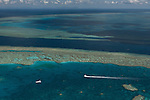 Aerial view of Hardy Reef with float plane, home to the heart reef,  in the Great Barrier Reef
