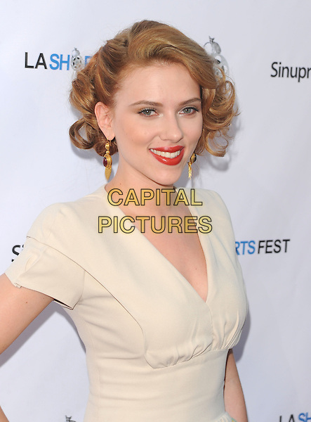 SCARLETT JOHANSSON .Opening Night of LA Shorts Fest at Laemmle Sunset 5 Theatres in West Hollywood, California, USA. .July 23rd, 2009 .half length dress white cream beige red lipstick dangling gold earrings.CAP/DVS.©Debbie VanStory/Capital Pictures.