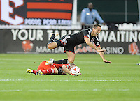 Washington D.C. - April 26, 2014:  Davy Arnaud (8) of D.C. United gets fouled by Zach Loyd (17) of FC Dallas. D.C. United defeated the FC Dallas 4-1 during a Major League Soccer match for the 2014 season at RFK Stadium.
