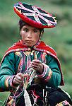 A Quechua girl spins wool, Peru