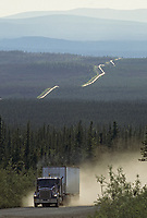 Semi truck, James Dalton Highway, Trans Alaska oil pipeline stretches across boreal forest, Alaska.