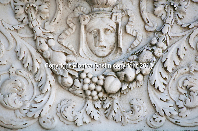 Detail of the carved marble face on the roof of the Duomo (Cathedral) in Milan, Italy.