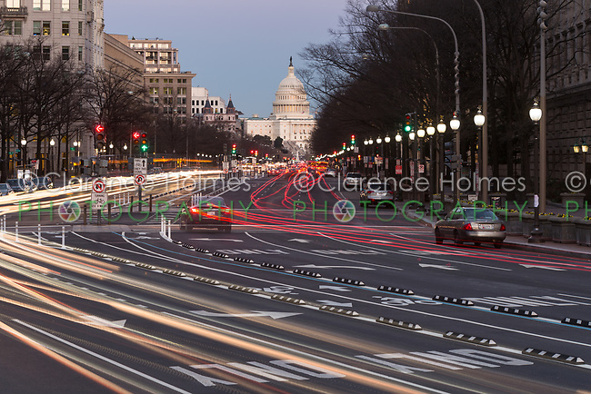 Traffic creates light trails and motion blurs leading to the US Capitol Building on Pennsylvania Avenue in Washington, DC.