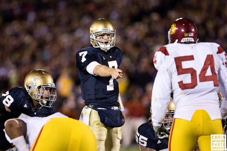 10/17/09 - South Bend, IN:  Notre Dame quarterback Jimmy Clausen attempts to tie the game in the fourth quarter against USC at Notre Dame Stadium on Saturday.  USC won the game 34-27 to extend its win streak over Notre Dame to 8 games.  Photo by Christopher McGuire.