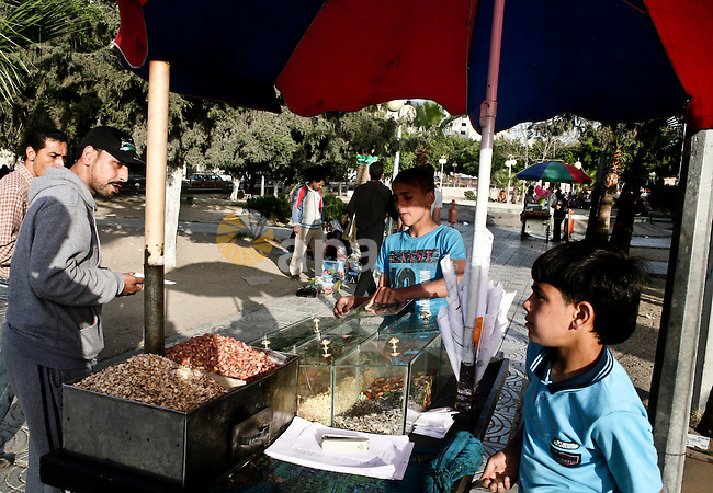 A Palestinian vendor sells nuts in a garden in Gaza city, 23 April 2012. With high rates of unemployment in Gaza strip. Photo by Ali Jadallah