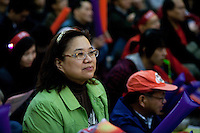 A woman is listening the speech of Tanya Chan at the pan-democrats rally in Hong-kong. Tuesday 26 ,january 2010.