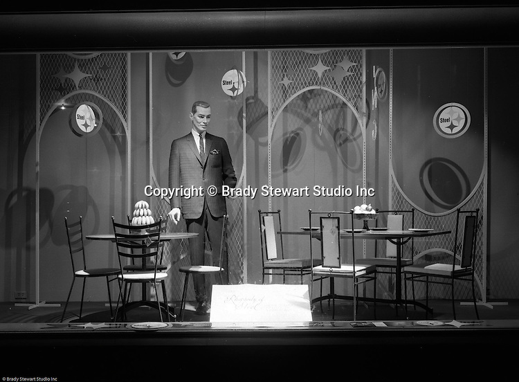 Pittsburgh PA: View of Christmas window display at Horne's department store in downtown Pittsburgh. Man dressed in suit in front of kitchen tables while surrounded by a steel display during the Rhapsody of Steel campaign. US Steel launched an awareness campaign of all the current uses of steel in everyday products.  During this time, ALCOA Aluminum Company of America also headquartered in Pittsburgh, was aggressively competing to enter markets where US  steel companies traditional dominated market share. Examples included beer and food Cans, appliances, automobile parts, children toys / bicycles, and more.