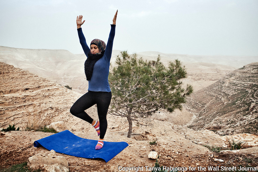 Hayat Abu R'maes, 25, and Nabila Albo, 39, have been teaching yoga for one year now. <br /> Here, they take students out on nature walk for yoga. Sometimes they go to nature spots (one popular spot w roman ruins) that settlers try to intimidate Palestinians from accessing, they say. They call it, &quot;inner resistance&quot;. <br /> <br /> When yoga classes started in Zatara village, on the outskirts of Bethlehem, the weekly class barely had students. Now they are so popular that despite the small excerise room that is utilized as an aerobics class, the center staggers five classes a week&hellip;..The room barely fits 15 students in each class.<br /> <br /> <br /> <br /> WSJ Photo Assignment # 25813 with Slug &quot;PALYOGA&quot;
