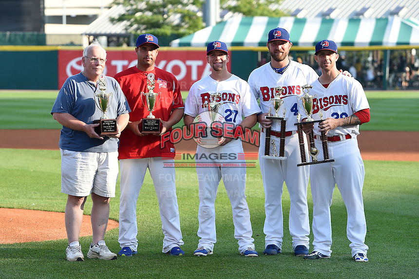 Buffalo Bisons award recipients Jim McGowan, Raul Valdes, Ryan Schimpf, Kyle Drabek and Bobby Korecky pose for a photo during a ceremony before a game against the Pawtucket Red Sox on August 26, 2014 at Coca-Cola Field in Buffalo, New  York.  Pawtucket defeated Buffalo 9-3.  (Mike Janes/Four Seam Images)