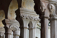 Capitals with human heads and floral motifs, atop pairs of 8-sided columns in the colonnade of the Cloister, built in late Romanesque style by Mihoje Brajkov of Bar in 1360, at the Franciscan monastery on Stradun or Placa, Old Town, Dubrovnik, Croatia. The city developed as an important port in the 15th and 16th centuries and has had a multicultural history, allied to the Romans, Ostrogoths, Byzantines, Ancona, Hungary and the Ottomans. In 1979 the city was listed as a UNESCO World Heritage Site. Picture by Manuel Cohen