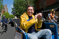 "New York, NY - 28 April 2009 - Civil RIghts attorney Norman Siegal, former Executive Director for the New York Civil Liberties Union and candidate for New York City Public Advocate, rides through the West Village in a pedicab during a campaign event entitled ""Cyclists For Norman Siegal"""