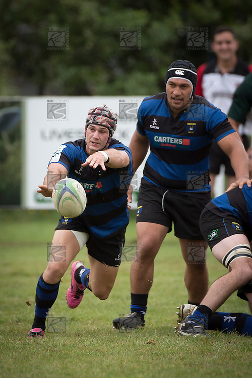 David Bason gets the ball away to the backs from a ruck as Tai Natuna watches. Counties Manukau Premier Club Rugby game between Onewhero and Manurewa, played at Onewhero on Saturday 20th of April 2013. Onewhero won the game 30 - 20 after leading 13 - 7 at halftime.