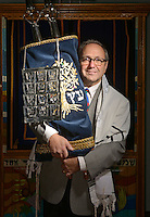 STAFF PHOTO BEN GOFF  @NWABenGoff -- 12/04/14 Rabbi Rob Lennick poses for a photo with the Torah at Waterway Christian Church in Cave Springs, where Congregation Etz Chaim holds services, on Thursday Dec. 4, 2014.