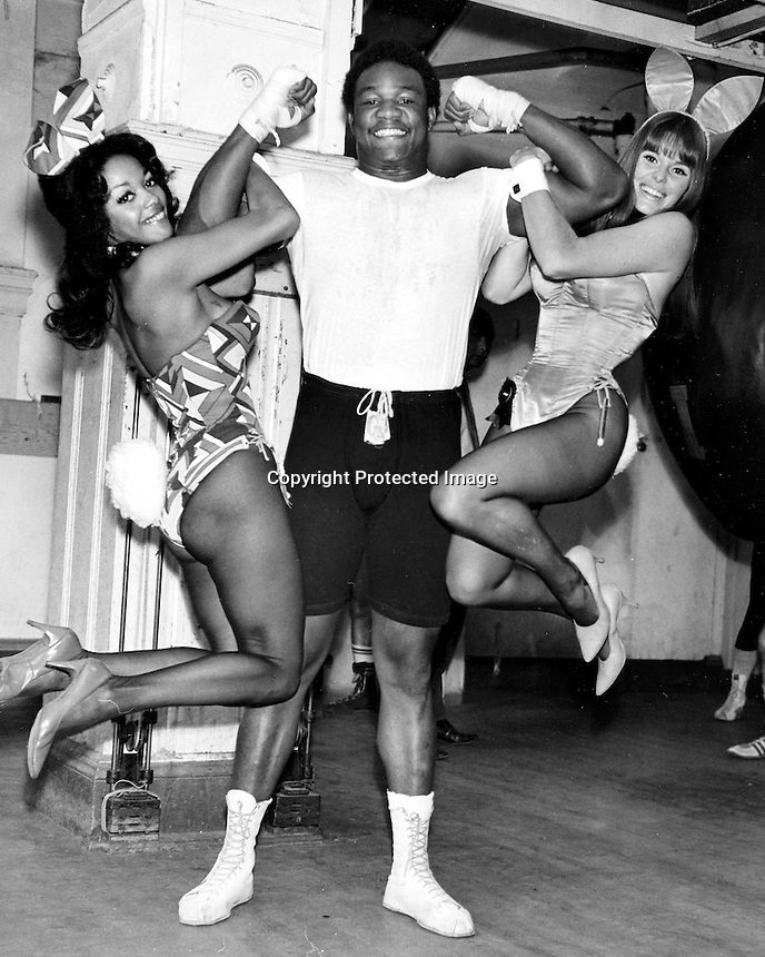 Heavyweight boxing  champ George Foreman with Playboy bunnies. ( 1973 photo by Ron Riesterer)