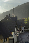 Smoke rising from chimneys roof in the Black forest. Tennenbron,Schramberg, Wurttemburg, Germany.