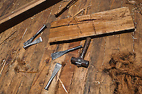 Caulking irons, caulking mallet and hemp fiber (oakum) are seen on the board of a traditional wooden fishing vessel in an artisanal shipyard on the beach in Manta, Ecuador, 9 September 2012. The construction process takes 3-4 months to complete, depending on the ship size and purpose (fish capture methods). Although a wooden boat tends to be more stable on the sea and less expensive to build (up to $0.5 million USD), it needs a maintenance every 2 years, while a fiberglass-made boat, costing almost double the wooden one, may serve 5-6 years without any repairs. The shipyard produces 6-8 vessels every year.