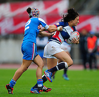 Kelly Smith of Great Britain takes on the Italy defence. FISU World University Championship Rugby Sevens Women's 5th/6th place match between Great Britain and Italy on July 9, 2016 at the Swansea University International Sports Village in Swansea, Wales. Photo by: Patrick Khachfe / Onside Images
