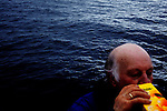 Vestfjorden, Nordland, Norway, 23.03.12..skipper Steinar getting a quick fix of orange juice...The vessel Anne Marie with skipper Steinar Henriksen and (blue cap) brought out Team Olsen at the Arctic Cod fishing world championship. On the first day three man Team Olsen caught 1205 kilos of cod using nothing but fishing poles in the five hours of fishing time. The team; Geir L. Olsen (glasses), Magne Øvregård (white hat/red rainclothes) and Peder E. Vik (dark hair) won first prize this Friday in Lofoten Cup (Peder 1st, Magne 2nd and Geir 3rd)...Photo by: Eivind H. Natvig/MOMENT