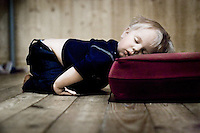 A little boy, so exhausted, that he has fallen asleep just where he were playing.