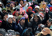 Baltimore, MD - January 17, 2009 -- Supporters cheer as United States President-elect  Barack Obama delivers remarks during a rally at War Memorial Plaza, during a stop on their Whistle Stop Train Tour, in Baltimore, Maryland on Saturday, January 17, 2009. The ceremonial trip will carry President-elect Obama, Vice President-elect Biden and their families to Washington for their inaugurations with additional events in Philadelphia, Wilmington and Baltimore. Obama will be sworn in as the 44th President of the United States on January 20, 2009.   .Credit: Kevin Dietsch - Pool via CNP
