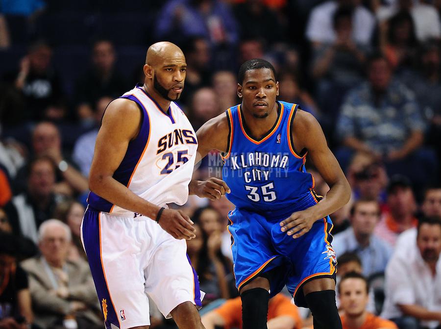 Mar. 30, 2011; Phoenix, AZ, USA; Oklahoma City Thunder forward (35) Kevin Durant against Phoenix Suns guard (25) Vince Carter at the US Airways Center. Mandatory Credit: Mark J. Rebilas-
