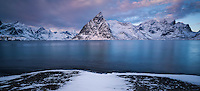Winter view over Olstind mountain peak, Toppøy, Lofoten Islands, Norway