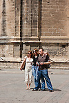 people around la giralda cathedral in sevilla, spain