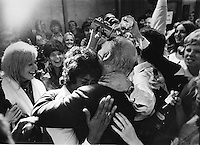 Oakland Athletics players wives mob and hug owner Charlie Finley in the dressing room after the A's beat the Cinncinnati Reds in the 7th game of the 1972 World Series. (1972 photo by Ron Riesterer)