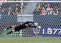 LA Galaxy Goal Keeper Josh Saunders (12) dives to his left making another save of the day. The LA Galaxy defeated Boca Juniors 1-0 at Home Depot Center stadium in Carson, California on Sunday May 23, 2010.  .