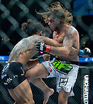 Clay Guida delivers a knee to the top of Benson Henderson's upper thigh in a lightweight match during Saturday's UFC on Fox event at the Honda Center.