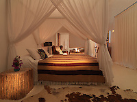 At night the bedroom is heated with an open fire which casts a warm glow over the four-poster bed